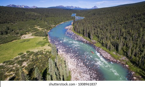 Aerial shot of a group paddling down the Nahanni River in Northwest Territories, Canada.