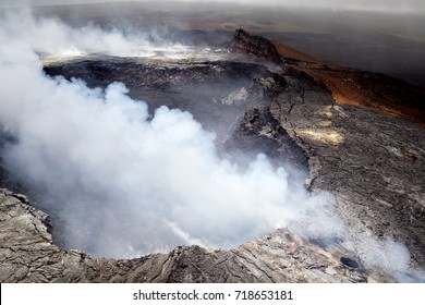 Aerial shot of the Halemaumau crater emitting volcanic fumes on the summit of the active volcano Kilauea on Big Island, Hawaii, USA.