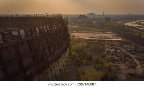 Aerial shot of a huge spherical structure in Chernobyl with mutant forest around