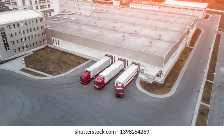 Aerial Shot of Industrial Warehouse Loading Dock where Many Truck