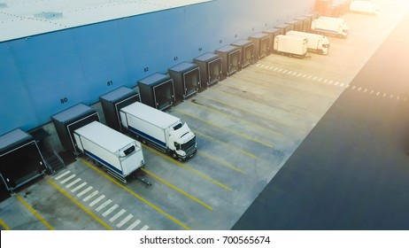 Aerial Shot of Industrial Warehouse Loading Dock where Many Truck with Semi Trailers Load Merchandise. - Shutterstock ID 700565674