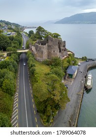 Aerial shot of King John's castle in Carlinford with Irish sea and mountains in the background. Co. Louth, Ireland. July 2020