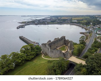 Aerial shot of King John's castle with Carlinford town and Irish sea in the background. Co. Louth, Ireland. July 2020