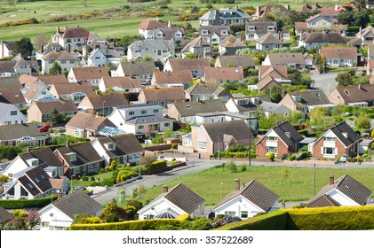 Aerial shot looking down on urban housing development - housing estate of mainly bungalows in Deganwy Wales. Housing market, economic property prices and property image.