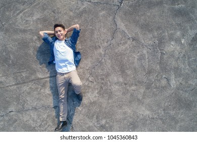 aerial shot of man feel free and lying on the floor