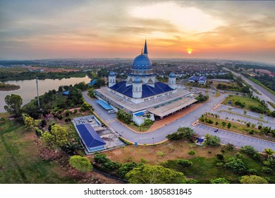 Aerial shot of a mosque during sunrise. Soft focus effect due to large setting and distortion effect due to panorama view