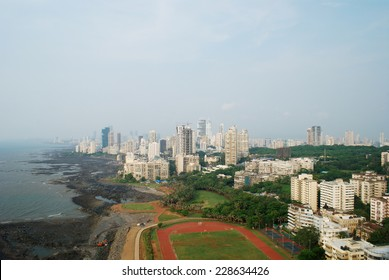 Aerial shot of Mumbai's afluent Napean Sea area with Arabian sea during day. Here most of super rich billionares and millionares stay in high-rise towers. Copy space.