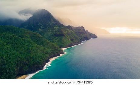Aerial shot of Napali Coast in Kauai Hawaii at sunset