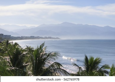 Aerial shot of Nuevo Vallarta, Nayarit shot by drone from the sky, clear water, Sierra Madre mountains