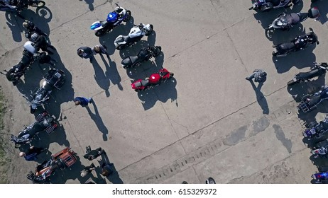 Aerial shot of outdoor motorcycle show, low altitude top view