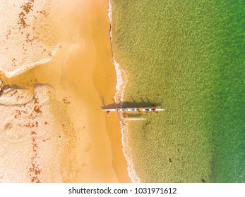 Aerial shot of an Outrigger Canoe ready to paddle into the ocean.