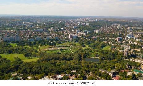 Aerial shot of a park in Chisinau City. Blue sky with clouds. Botanica, Chisinau, Moldova