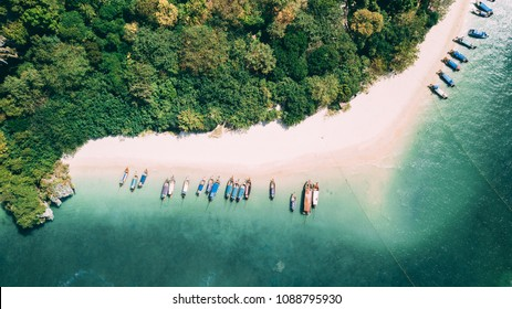 Aerial shot of Phra Nang beach in Thailand with long tail boats