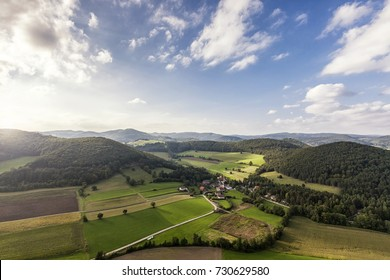 Aerial Shot of picturesque landscape of the Vienna Woods in Lower Austria with little village Untermeierhof