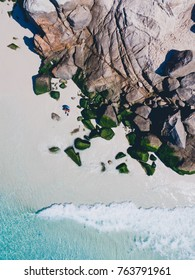aerial shot with plain view of the beautiful and famous prainhas beach in arraial do cabo, rio de janeiro, brazil. beautiful rocks and blue water, with drone pilot