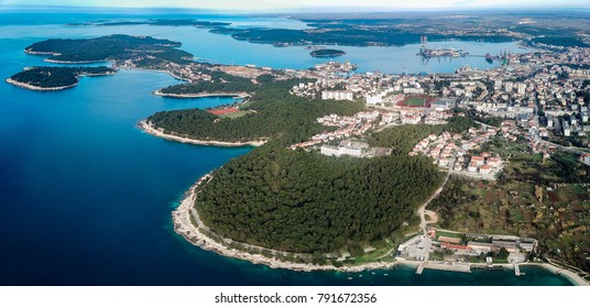 Aerial shot of Pula,Croatia. Known for its multitude of ancient Roman buildings, the most famous of which is the Pula Arena, one of the best preserved Roman amphitheaters, and its beautiful sea.