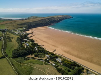 Aerial shot of Putsborough beach and surrounding coastal countryside in Devon, United Kingdom