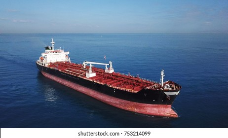 Aerial shot of red deck tanker ship sailing on open sea