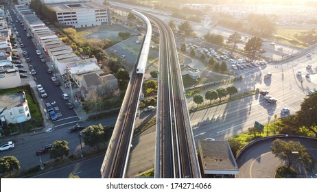 An aerial shot of the San Francisco Bay Area Rapid Transit  (BART)the  train approaches Daly City Station, USA