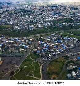 Aerial shot showing blue tarpaulin roofs of destroyed homes in San Juan, Puerto Rico six months after hurricane Irma & Maria. Jan 2018