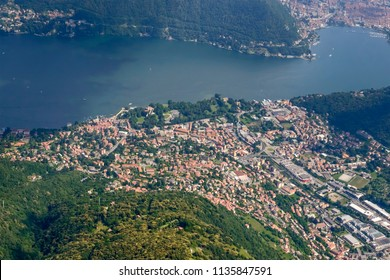 aerial shot, from a small plane, of Cernobbio village on western side of Como lake , shot on a bright early summer day from above Chiasso, Como, Lombardy, Italy