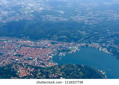 aerial shot, from a small plane, of Como town on Lario lake, shot on a bright late springtime day at Como, Lombardy, Italy