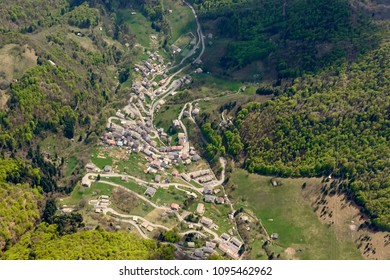 aerial shot, from a small plane, of Cusio mountain village, shot on a bright springtime day in Orobie, Bergamo,  Lombardy , Italy