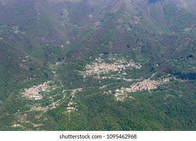 aerial shot, from a small plane, of Erno, Veleso and Zelbio mountain villages, shot on a bright springtime day in Tivano valley, Como,  Lombardy , Italy