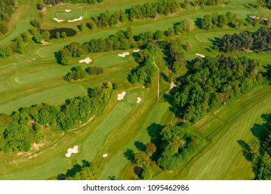 aerial shot, from a small plane, of fairways with springtime green at golf course, shot on a bright spring day near Bergamo,  Lombardy , Italy