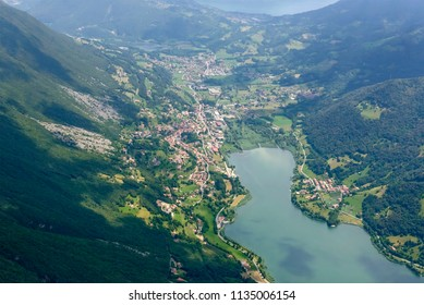aerial shot, from a small plane, of Gaiano village on eastern side of Endine lake , shot on a bright early summer day in Cavallina valley, Endine,  Bergamo, Lombardy, Italy