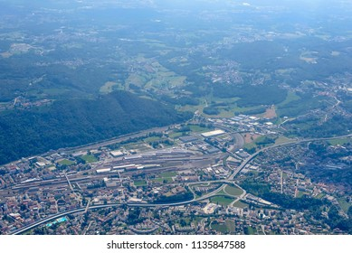 aerial shot, from a small plane, of large railway yard , shot on a bright early summer day at Chiasso, Ticino, Switzerland