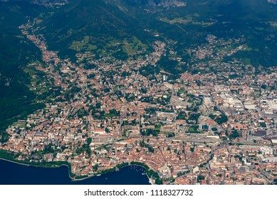 aerial shot, from a small plane, of Lecco town on Lario lake, shot on a bright late springtime day at Lecco, Lombardy, Italy