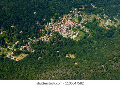 aerial shot, from a small plane, of Marzio touristic mountain village, shot on a bright early summer day, Varese,  Lombardy, Italy