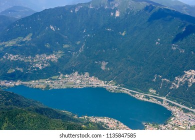 aerial shot, from a small plane, of Melano touristic village on Lugano lake , shot on a bright early summer day, Ticino, Switzerland
