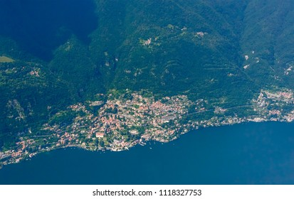 aerial shot, from a small plane, of Moltrasio village on western side of Como lake , shot on a bright late springtime day near Como, Lombardy, Italy