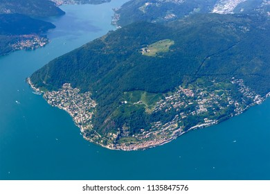 aerial shot, from a small plane, of Morcote touristic village on Lugano lake , shot on a bright early summer day, Ticino, Switzerland