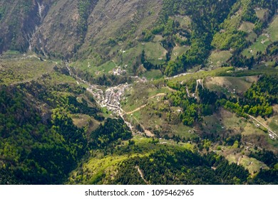 aerial shot, from a small plane, of Ornica mountain village, shot on a bright springtime day in Orobie, Bergamo,  Lombardy , Italy