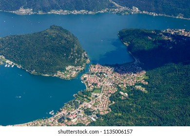aerial shot, from a small plane, of Ponte Tresa touristic village on Lugano lake , shot on a bright early summer day, Varese,  Lombardy, Italy