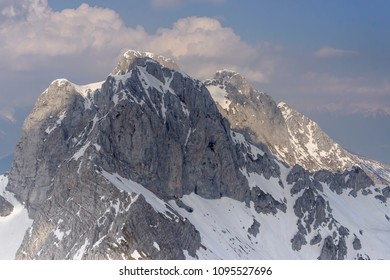 aerial shot, from a small plane, of Presolana peak range shot in Orobie mountains in bright springtime light, Bergamo , Italy