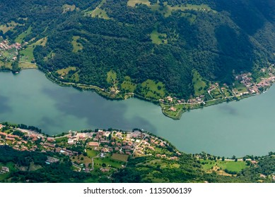 aerial shot, from a small plane, of Ranzanico Lago village on western side of Endine lake , shot on a bright early summer day in Cavallina valley, Endine,  Bergamo, Lombardy, Italy