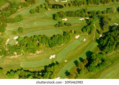aerial shot, from a small plane, of springtime green at golf course, shot on a bright springtime day near Bergamo,  Lombardy , Italy
