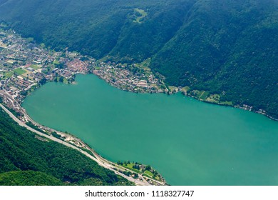 aerial shot, from a small plane, of S.Vitale village on the south rim of Lugano lake, shot on a bright late springtime day in  Ticino, Switzerland