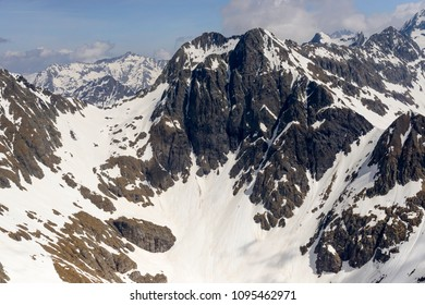 aerial shot, from a small plane, of Tenda Diavolo peak  steep cliffs shot in Orobie mountains in bright springtime light, Bergamo , Italy