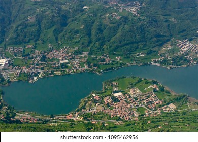 aerial shot, from a small plane, of touristic Monestitolo village and Endine lake, shot on a bright springtime day from east, Bergamo,  Lombardy , Italy