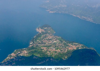 aerial shot, from a small plane, of touristic Bellagio village and paninsula, shot on a bright springtime day from south, Como,  Lombardy , Italy