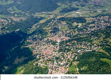 aerial shot, from a small plane, of touristic mountain village in Valsassina valley, shot on a bright early summer day at Cremeno, Lecco, Orobie, Lombardy, Italy