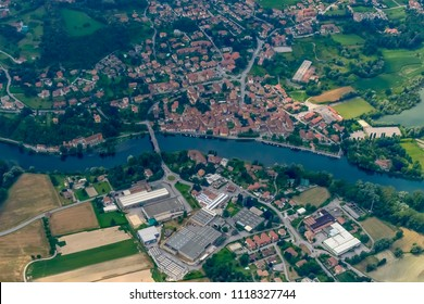 aerial shot, from a small plane, of village and bridge on Adda river, shot on a bright late springtime day at Brivio, Bergamo, Lombardy, Italy