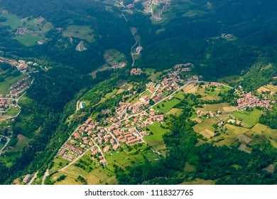aerial shot, from a small plane, of village on hills near Adda river, shot on a bright late springtime day at S.Antonio of Adda, Bergamo, Lombardy, Italy
