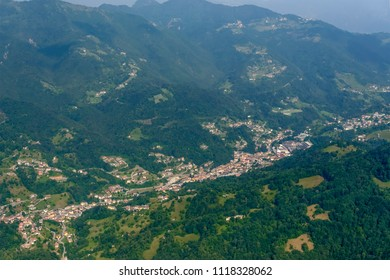 aerial shot, from a small plane, of village in Imagna valley, shot on a bright late springtime day at S.Omobono, Bergamo, Orobie, Lombardy, Italy