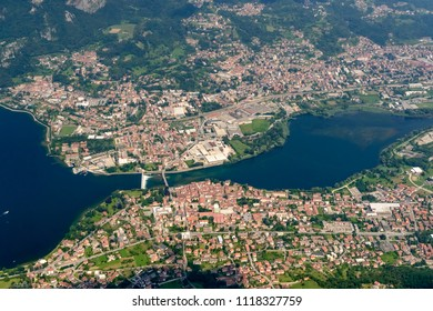 aerial shot, from a small plane, of villages on Adda river, shot on a bright late springtime day at Calolziocorte, Lombardy, Italy